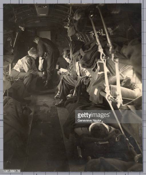 Military personnel accompany wounded soldiers on a military medical aircraft to the nearest Army hospital during the Korean War From Cosmopolitan...