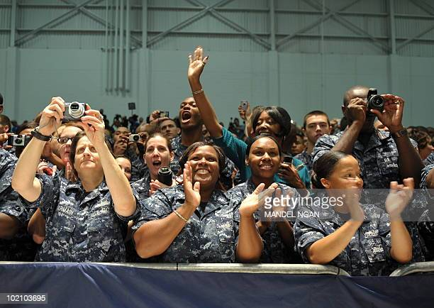 Military personnel applaud as US President Barack Obama speaks at the Naval Air Technical Training Center of the Pensacola Naval Air Station June 15...