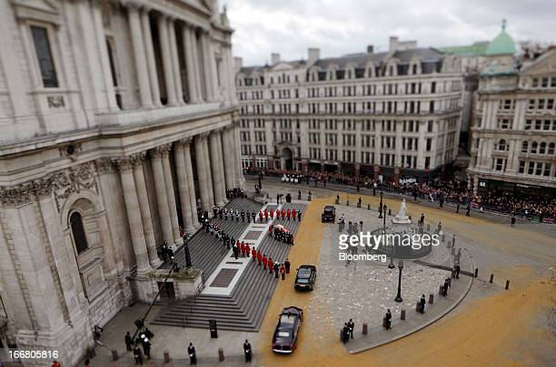 Military personnel are seen carrying the casket bearing the body of the former UK Prime Minister Margaret Thatcher draped in the British Union flag...