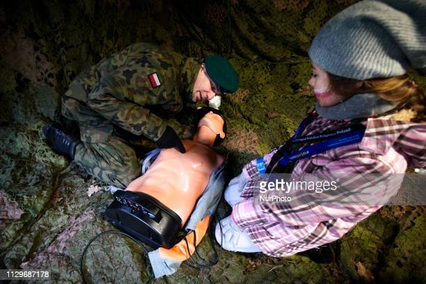 Military personnel are seen educating visitors on how to perform CPR in Bydgoszcz Poland on March 9 2019 The local military base organized a public...