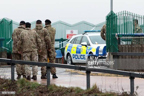 Military personnel are seen outside Salisbury District Hospital where a number of potentially contaminated vehicles are to be removed after former...