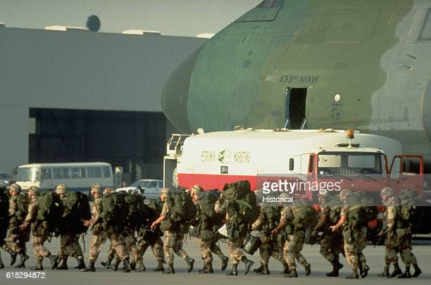 US military personnel arrive at Dhahran International Airport aboard a 433rd Military Airlift Wing C5A Galaxy aircraft during Operation Desert Shield...