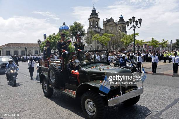 Military personnel arrive with the coffin of former Guatemalan President and Guatemala City Mayor, Alvaro Arzu, during his funeral at Culture Palace...