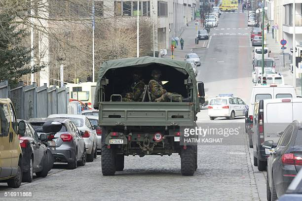 Military personnel arrives at the Rue de la Loi following its evacuation after an explosion at the Maalbeek Maelbeek subway station in Brussels on...