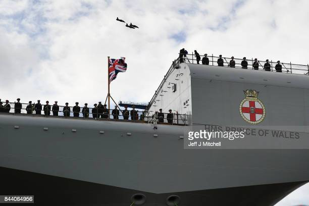 Military personnel attend a naming ceremony for the aircraft carrier HMS Prince of Wales at Rosyth Dockyard on September 8 2017 in Rosyth Scotland...