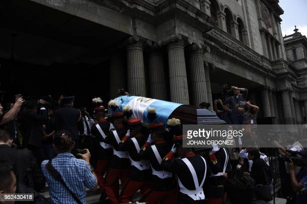 Military personnel carry the coffin of former Guatemalan President and Guatemala City Mayor Alvaro Arzu during his funeral at Culture Palace in...