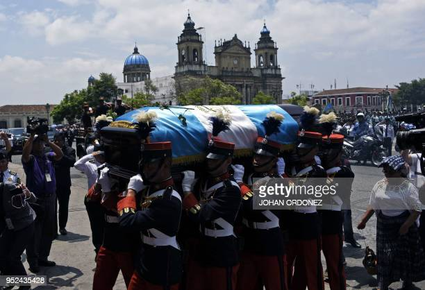 Military personnel carry the coffin of former Guatemalan President and Guatemala City Mayor, Alvaro Arzu, during his funeral at Culture Palace in...