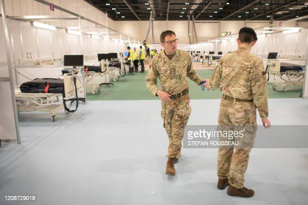 Military personnel continue work inside the ExCel centre in London on March 31 which has been transformed into a field hospital comprising of two...