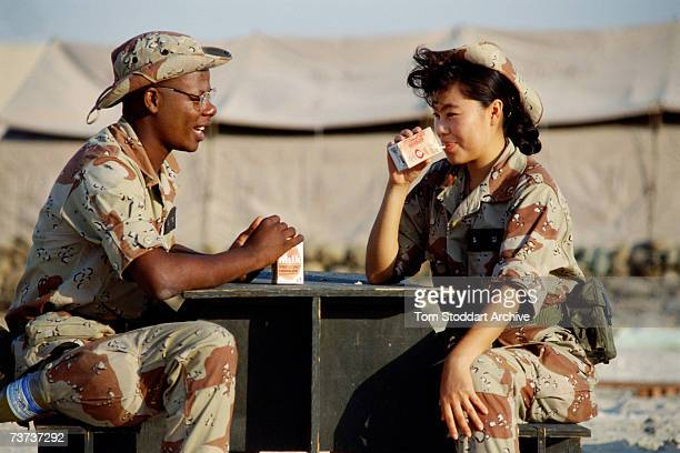 US military personnel enjoy chocolate milk drinks during a break in their duties at Dhahran military airbase Saudi Arabia during the Gulf War...