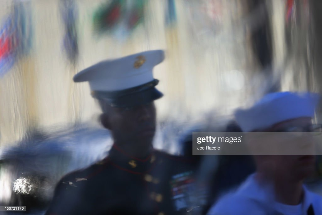Military personnel from the Joint Color Guard are seen through a plastic sheet before the start of the change of command ceremony at the United States Southern Command on November 19, 2012 in Doral, Florida. U.S. Marine Gen. John Kelly takes over the command from U.S. Air Force Gen. Douglas Fraser.