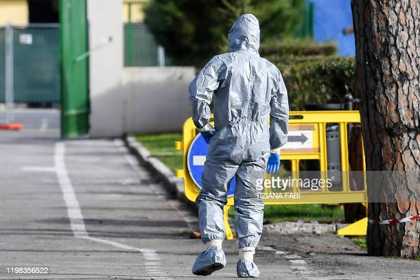 A military personnel in protective gear walks across the Cecchignola quarantine center south of Rome on February 3 2020 where Italian citizens have...