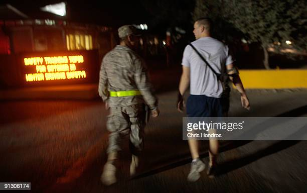 US military personnel in uniform and in workout clothes walk along Disney Road the main street of Bagram Air Base on October 1 2009 in Bagram...