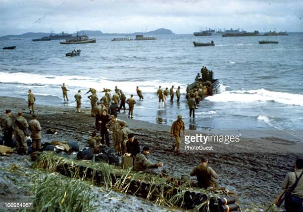 US military personnel land on an unspecified beach and unload men and equipemnt during the Aleutian Islands Campaign early 1940s