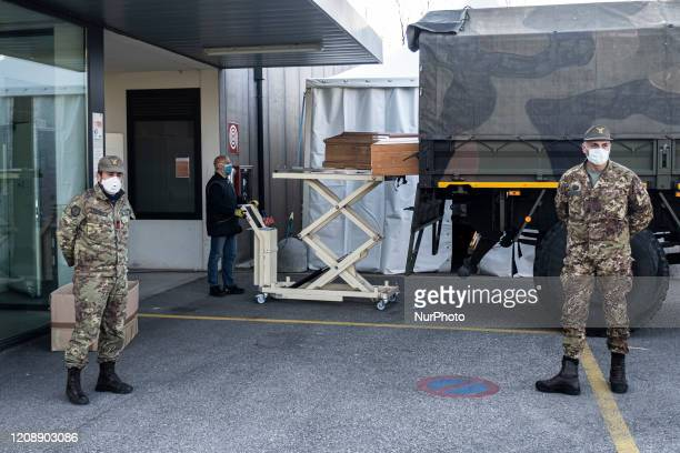 Military personnel leave the churches from Bergamo to carry coffins of coronavirus pandemic victims to crematorium in Padova, Italy, on April 1, 2020.