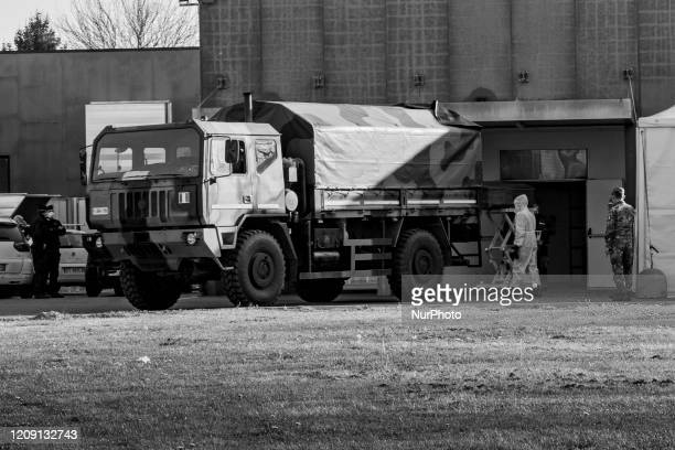 Image was converted to black and white) Military personnel leave the churches from Bergamo to carry coffins of coronavirus pandemic victims to...