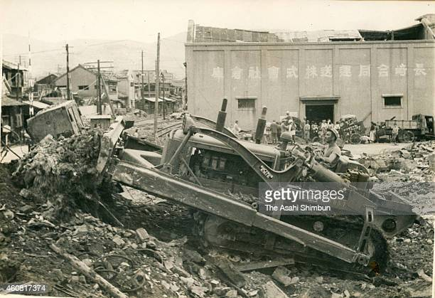 A US military personnel level the land scattered debris of the atomic bomb on September 25 1945 in Nagasaki Japan The world's first atomic bomb was...