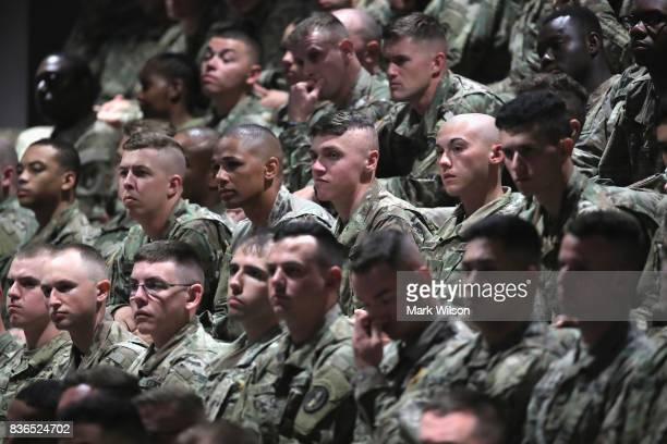 Military personnel listen to President Donald Trump deliver remarks on Americas involvement in Afghanistan at the Fort Myer military base on August...