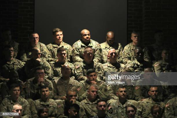 S military personnel listen to President Donald Trump deliver remarks on Americas involvement in Afghanistan at the Fort Myer military base on August...