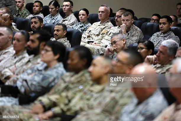 Military personnel listen to US Secretary of Defense Ash Carter during a questionandanswer session at Camp Arifjan on February 23 2015 in Kuwait...