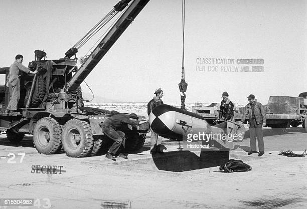 Military Personnel Loading Bomb onto Crane