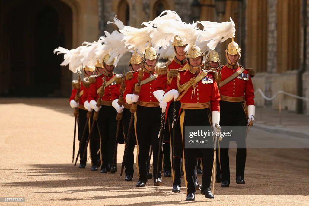 Military personnel march through the Quadrangle of Windsor Castle before the arrival of Queen Elizabeth II and The President of the United Arab Emirates, His Highness Sheikh Khalifa bin Zayed Al Nahyan, on April 30, 2013 in Windsor, England. The President of the United Arab Emirates is paying a two-day State Visit to the United Kingdom, staying in Windsor Castle as the guest of Her Majesty The Queen from April 30, 2013 to May 1, 2013. Sheikh Khalifa will meet the British Prime Minister David Cameron tomorrow at his Downing Street residence.