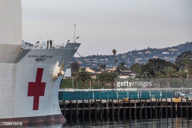 Military personnel of the US Navy Hospital ship Mercy wave to people on March 28 2020 at the Port of Los Angeles in the city of San Pedro to help...