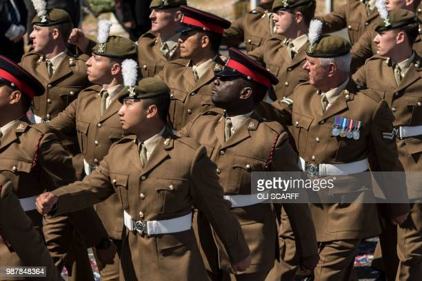 Military personnel parade past Britain's Princess Anne Princess Royal and dignitaries during the national Armed Forces Day celebrations at Llandudno...