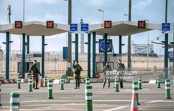 Military personnel patrol at the checkpoint of the frontier police on November 22 2016 at the port of Calais northern France one month after France's...