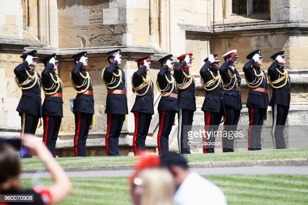 Military personnel salute at the wedding of Prince Harry to Ms Meghan Markle at St George's Chapel Windsor Castle on May 19 2018 in Windsor England