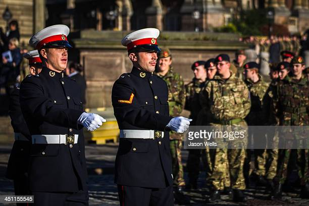 Military personnel seen marching at the Service of Remembrance at The Cenotaph, St George's Hall, Liverpool .