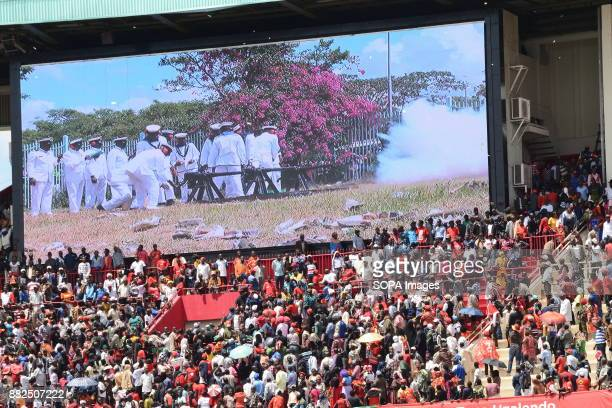 Military personnel seen on the display screen in the Kasarani Stadium as they fire a 21 gun salute to mark the inauguration of Uhuru Kenyatta the...