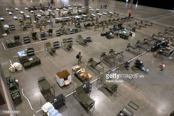 Military personnel set up the 627th Hospital Center field hospital at CenturyLink Event Center on March 31 2020 in Seattle Washington 250 beds...