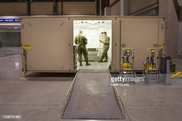 Military personnel set up the operating room at the 627th Hospital Center field hospital at CenturyLink Event Center on March 31 2020 in Seattle...