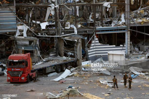 Military personnel stand amid debris from nearby structures, damaged by an explosion a day earlier, on August 5, 2020 in Beirut, Lebanon. As of...