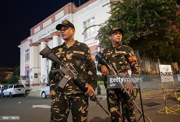 Military personnel stand guard in front of the city hall in Davao City in the southern island of Mindanao on September 4 two days after a bomb...