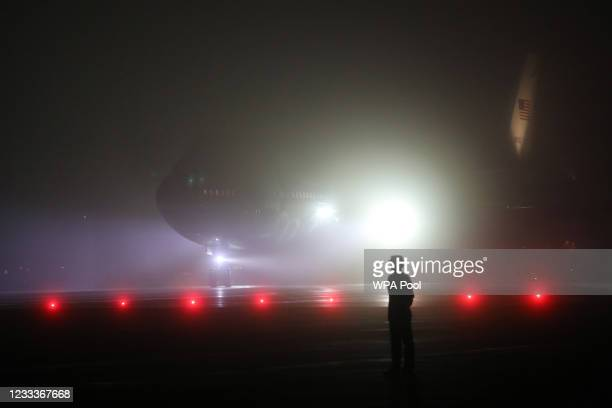 Military personnel stand on the tarmac as U.S. President Joe Biden and first lady Jill Biden arrive on Air Force One at Cornwall Airport Newquay, on...