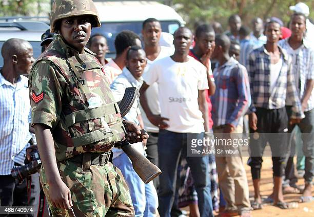 A military personnel stands guard after the AlShabaab terrorists' gun attack in Garissa University College on April 3 2015 in Nairobi Kenya At least...