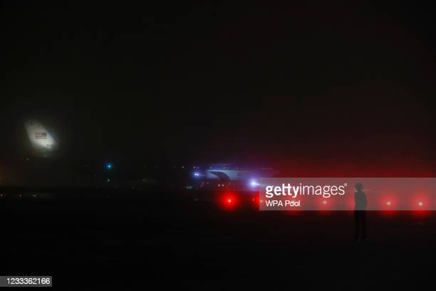 Military personnel stands on the tarmac as U.S. President Joe Biden and first lady Jill Biden arrive on Air Force One at Cornwall Airport Newquay, on...