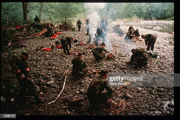 Military personnel train in building a fire at the US Air Force Survival Training Center September 13 1995 in Olympic National Park WA Serving as a...