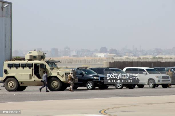 Military personnel wait to welcome members of the new unity government at the Aden Airport on December 30 before explosions rocked the southern...