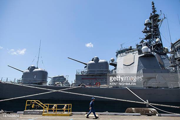 A military personnel walks past the JS Shirane as the vessel sits pier side at Joint Base Pearl HarborHickam in support of Rim of the Pacific 2012 on...