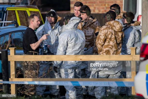 Military personnel wearing protective suits cover an ambulance as they prepare to remove it from Salisbury ambulance station as they continue...