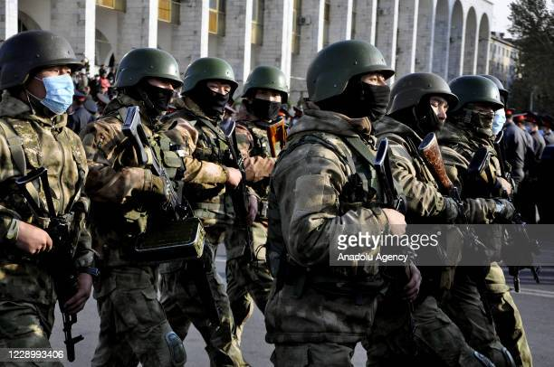 Military personnels and police officers parade at Ala-Too Square as supporters of Sadyr Japarov continue their protest in Bishkek Kyrgyzstan on...
