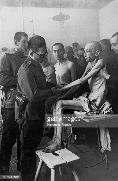 Military Physician Of The Red Army Examines A Surviving Deportee On January 27Th 1945.