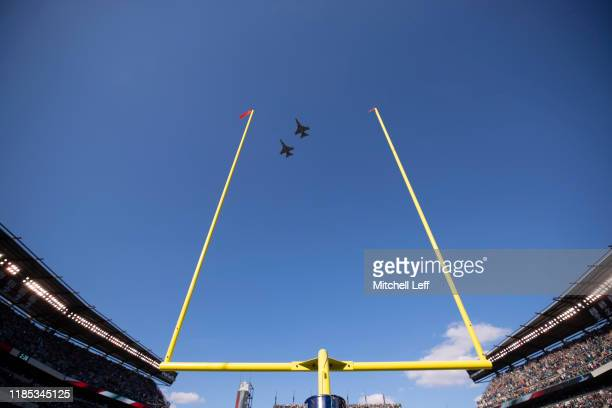 A military planes fly between the goalposts prior to the game between the Chicago Bears and Philadelphia Eagles at Lincoln Financial Field on...
