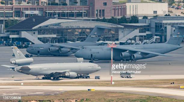 Military planes of the United States Air Force stand on the tarmac of Ramstein air base on July 20, 2020 in Ramstein-Miesenbach, Germany. The...