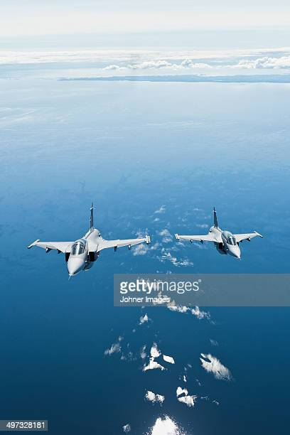 military planes - fighter stock pictures, royalty-free photos & images
