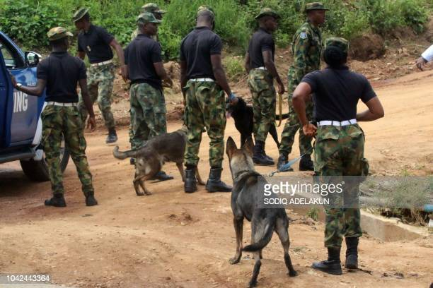 Military police arrive on Katampe Hills on the outskirts of Abuja where two Nigerian Air Force fighter jets taking part in rehearsals ahead of the...