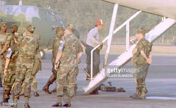 US military police at the Howard air force base in Panama provide security for Cuban refugees boarding a commercial flight taking them to the...