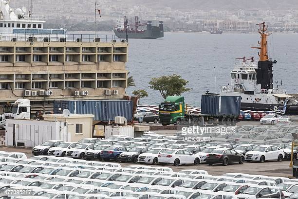 Military police escorts a truck carrying a container to a nearby navy base on March 9 2014 at the southern Israeli port of Eilat where Israeli army...